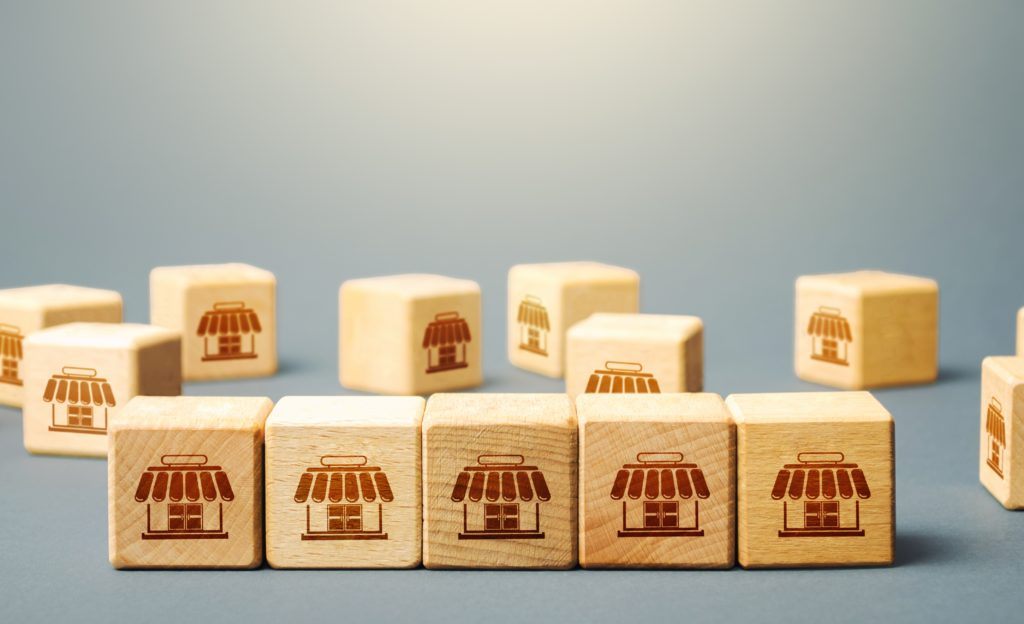 wooden blocks with storefronts stamped into them